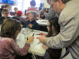 Before tackling the circuit board and real electronic components, the kids practiced on soldering wires together.