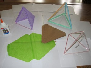 Prototype tetrahedrons and cutout tissue paper. Building a template helps considerably. We used string to tie the straws and cells together, but I'm working on designing a 3D printed connector to see if that would work.