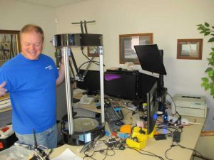 "Steve ""parts daddy"" shows off a newly assembled Rostock Max V3 on his desk."