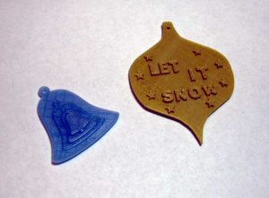 Two of the 3D printed ornament designs from the Castlemakers Kids meeting.