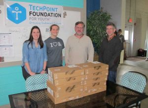 Maggie Cline & Courtney Lambert from TF4Y give Brian Howard & Chris Hebb new Dell Chromebooks for Castlemakers.