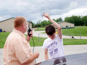 Testing a newly built antenna in the parking lot.