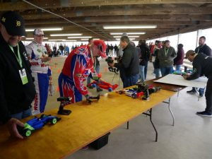 "3D printed R/C car racing was held next to the ""Livestock Potty Area"" at the 4H Fairgrounds."