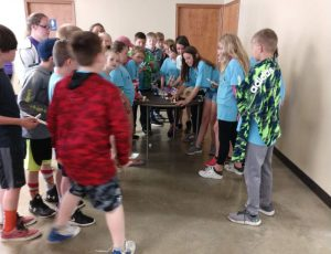 Putnam County Kids Count catapult design testing with fruit, candy and marshmallows.