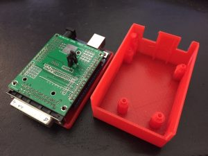 3D printed case for the Arduino GRBL shield. There is also a print-in-place button in the upper left corner of the case.