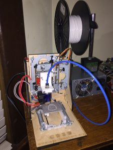 3D printer made from old CD parts.